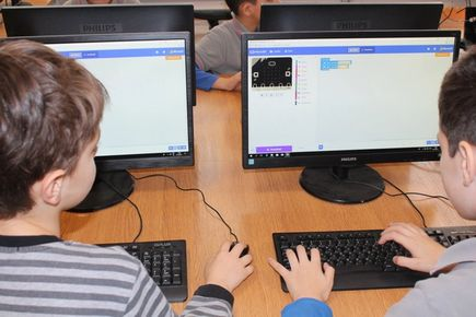 two young boys working on Makecode