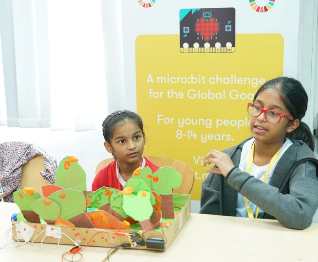 a young girl with her micro:bit invention