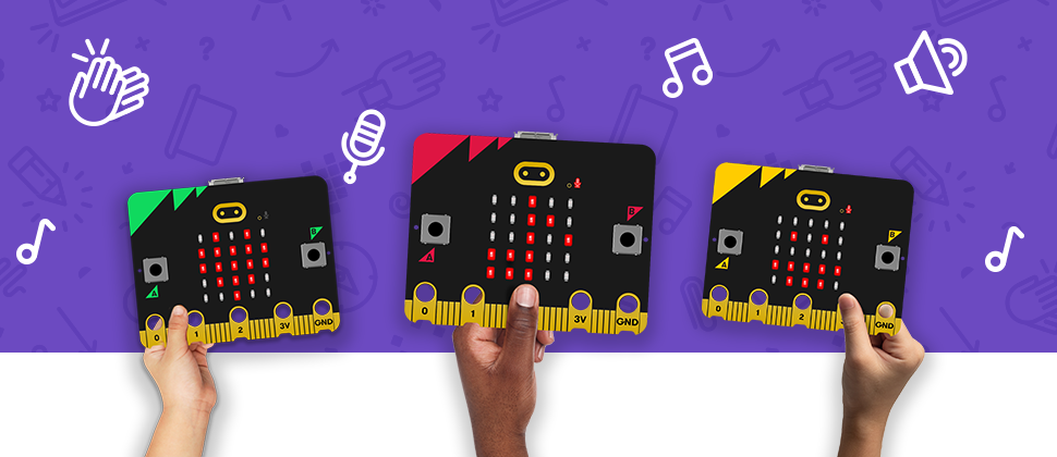 three children's hands holding the new micro:bit