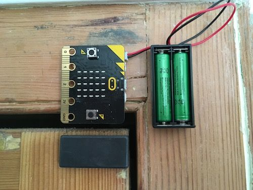 a magnet on the edge of a door near a micro:bit on the door frame