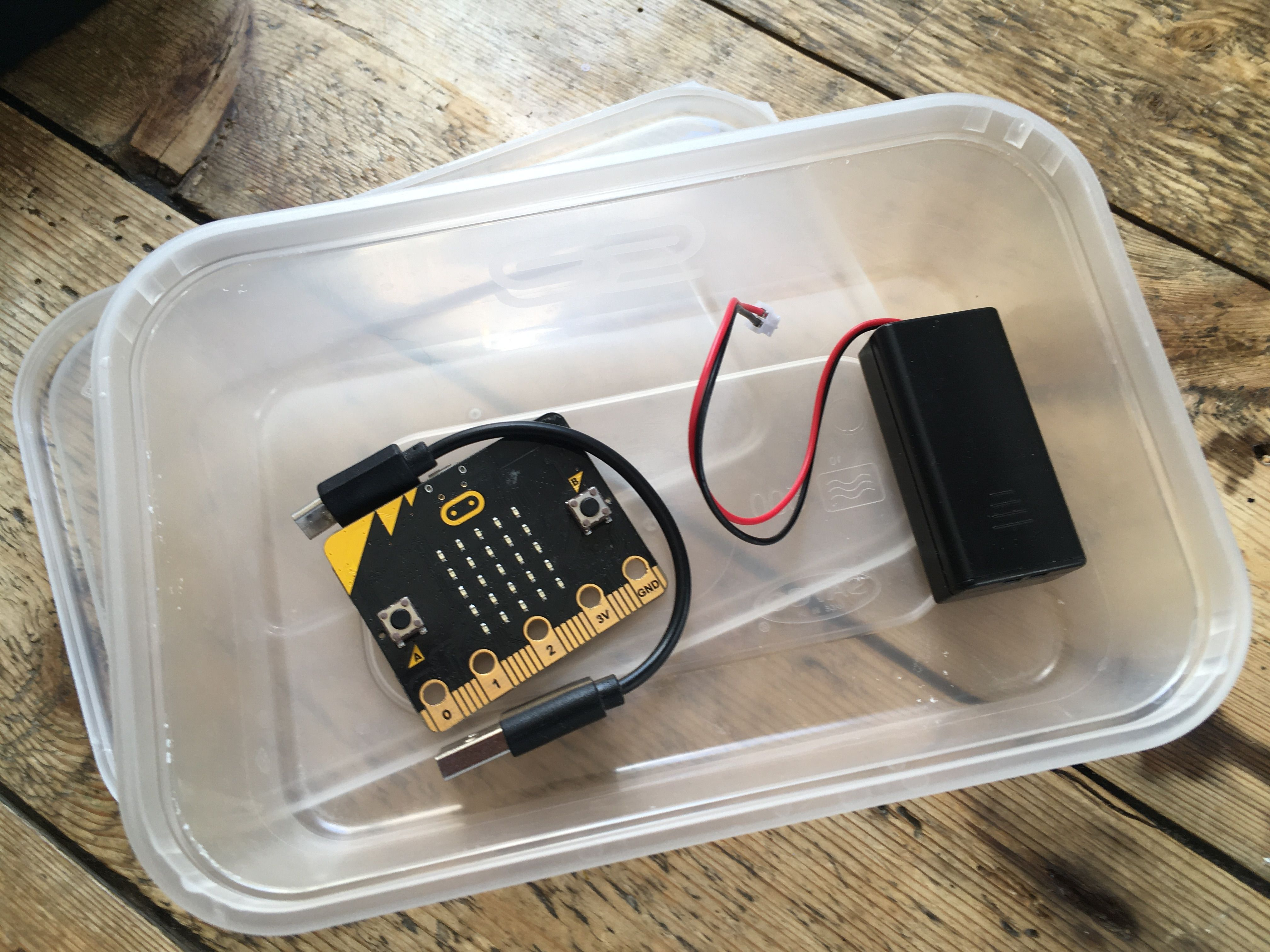 micro:bit stored in inexpensive food container