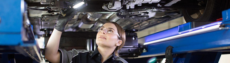 Mechanic working underneath car