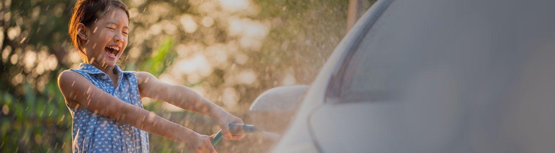 Girl washing a car