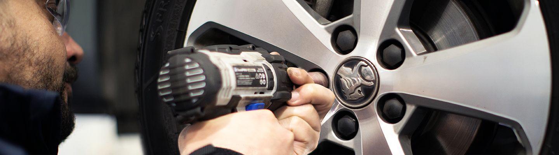 Mechanic repairing a car tyre