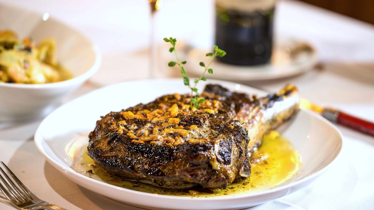 Beef tomahawk in butter & garlic is a Jacksonville signature meal