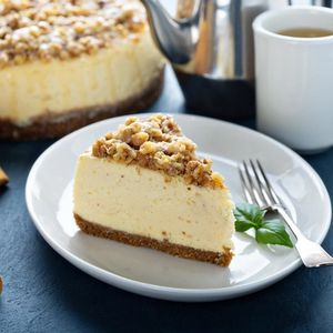 Pecan caramel cheesecake on the table.
