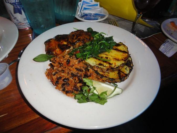 Latin Spice Grilled Mahi Mahi with Mango Chile Mojo, Grilled Pineapple, Hot Spinach and Rice 'n Beans.