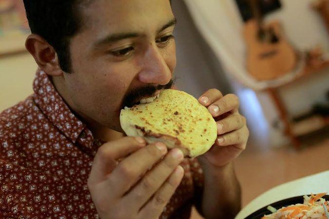 Rodriguez eating pupusas