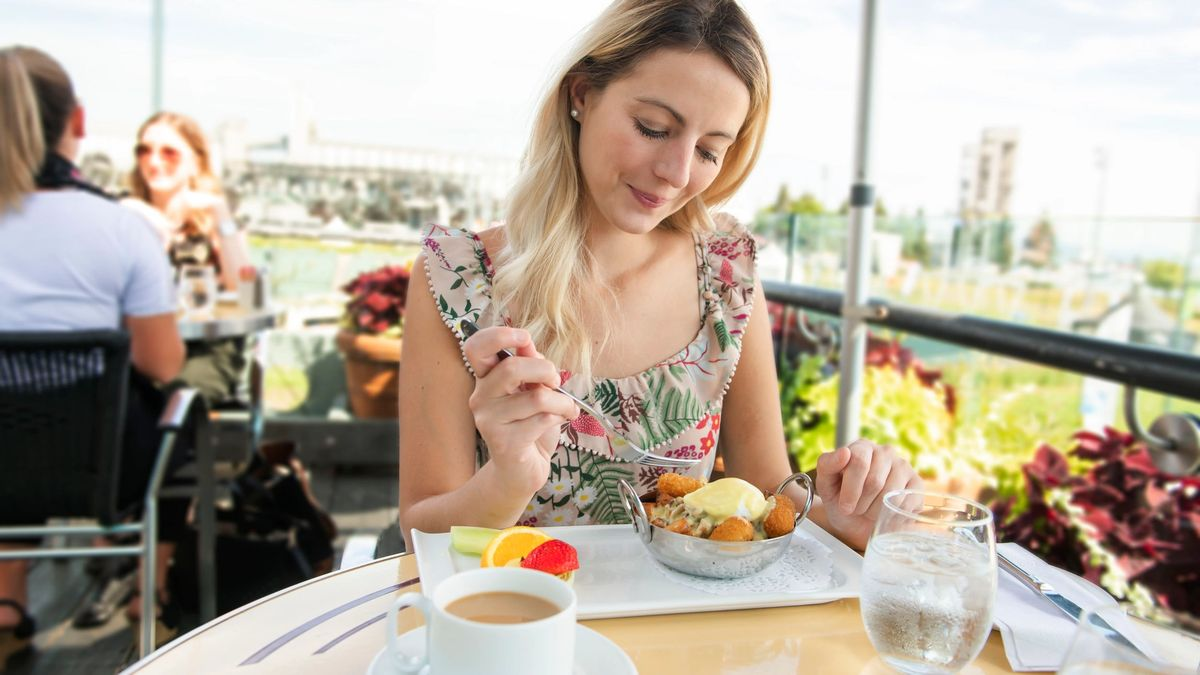Young woman sitting tourist sit for the breakfest with coffee