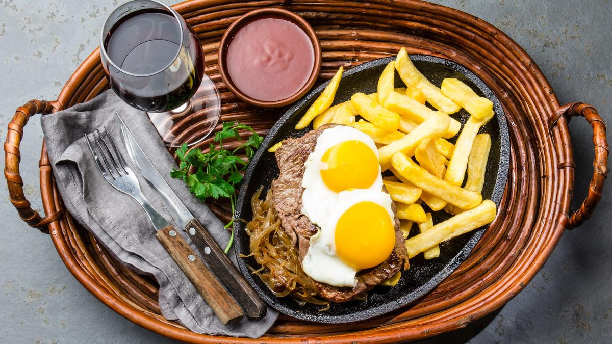 Peruvian Latin American food. Lomo a lo pobre. Beef tenderloin whit fried potatoes french fries and eggs