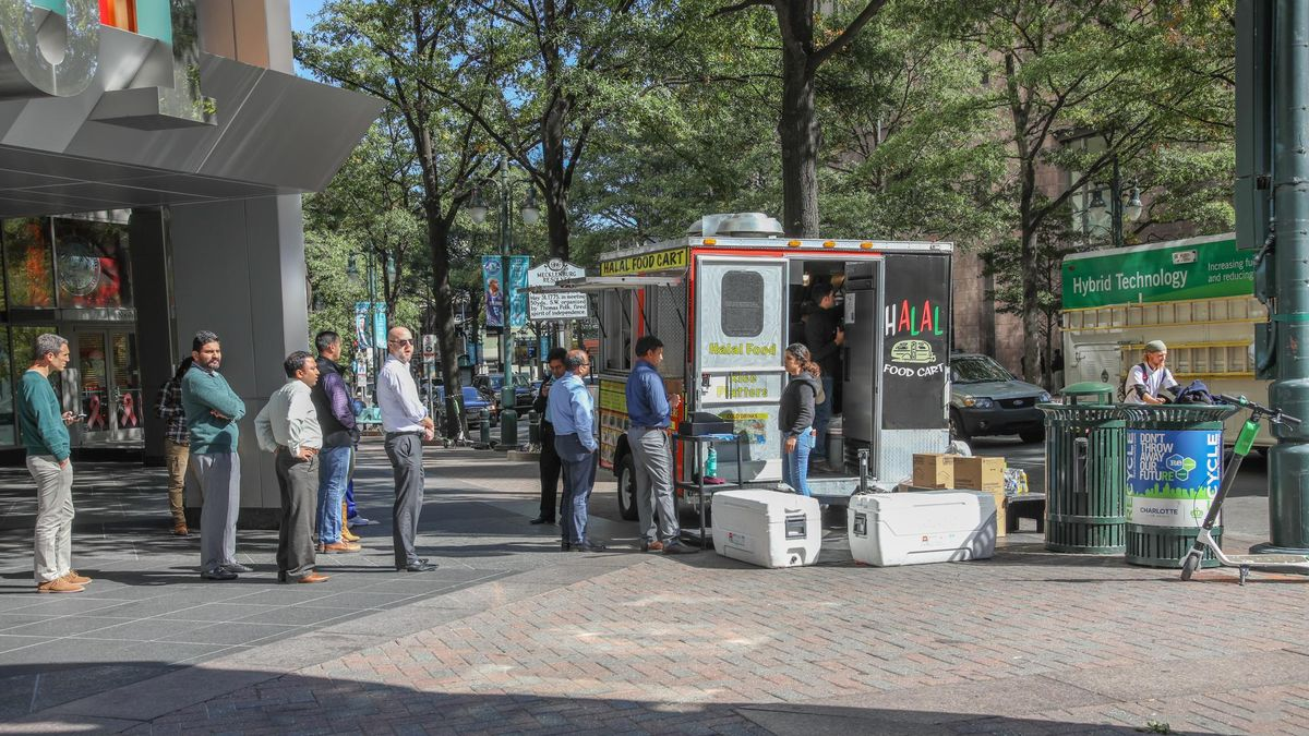 CHARLOTTE, NC, USA-10/30/18:  Customers waiting in line at a food cart on Tryon St.