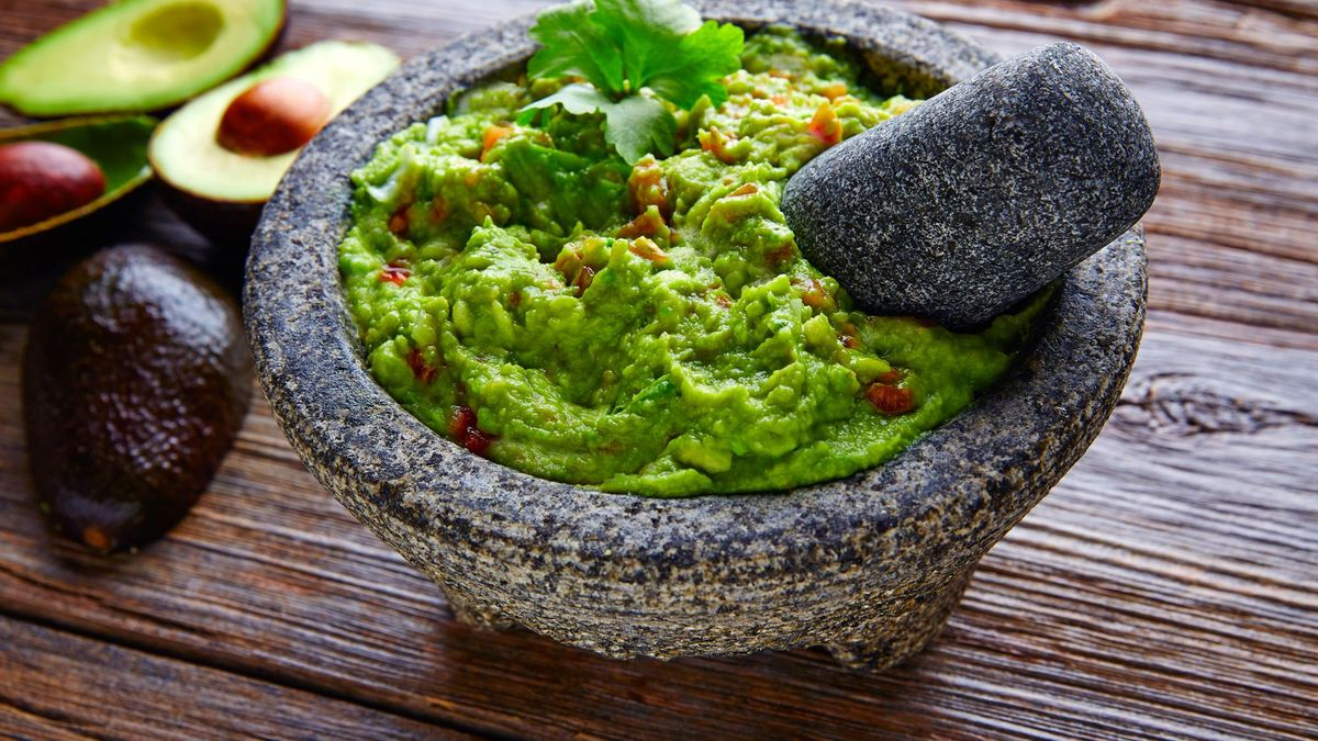 avocado Guacamole on molcajete real Mexican traditional procedure