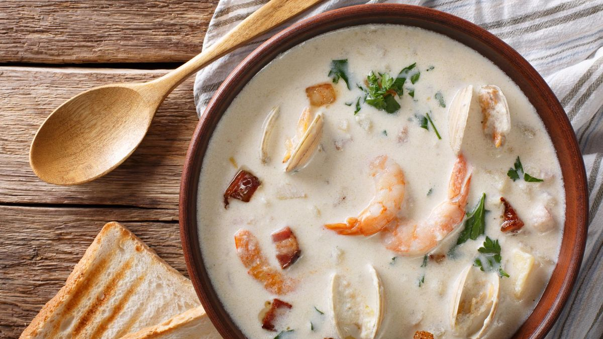 American food: New England clam chowder soup close-up on a in a bowl on the table. horizontal view from above