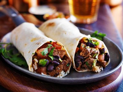 two beef burritos with rice, black beans and salsa