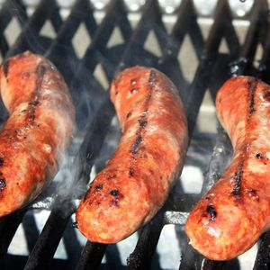 Brats Cooking on the Grill