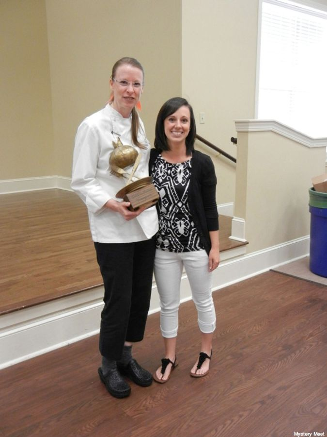 Chef Hilary White, Inaugural Golden Onion Champion, and Georgia artist Melissa Harris who designed and produced the Golden Onion trophy