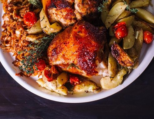 Chicken thigh with rosemary and potatoes. View from above.