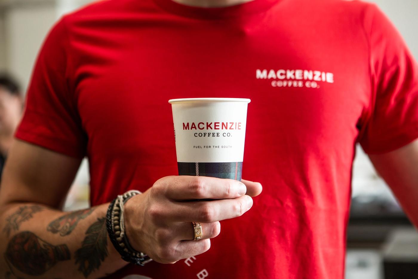 Mackenzie Coffee Co Cup in hand