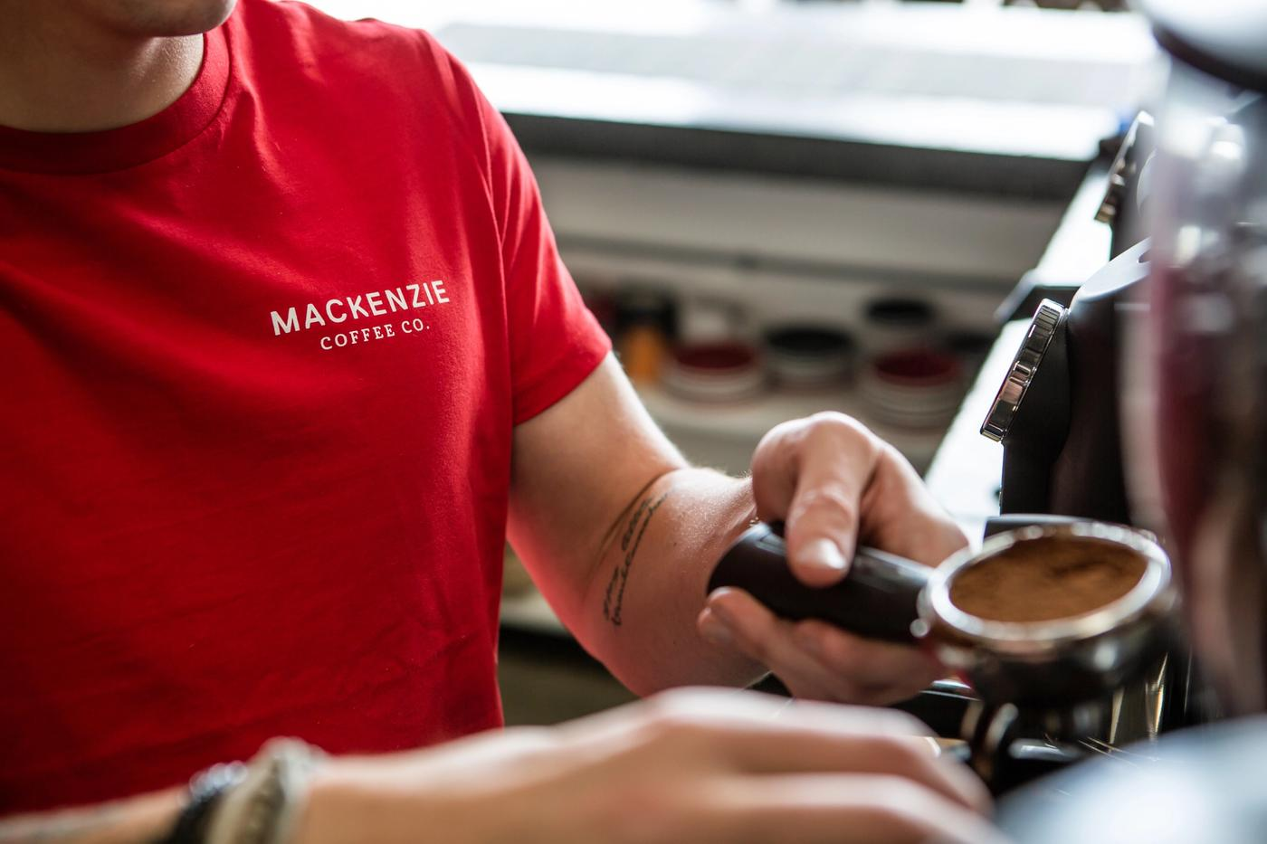 Barista making mackenzie coffee