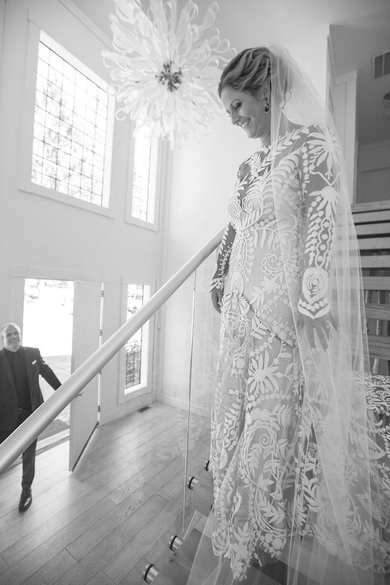 Black and white bride on stairs