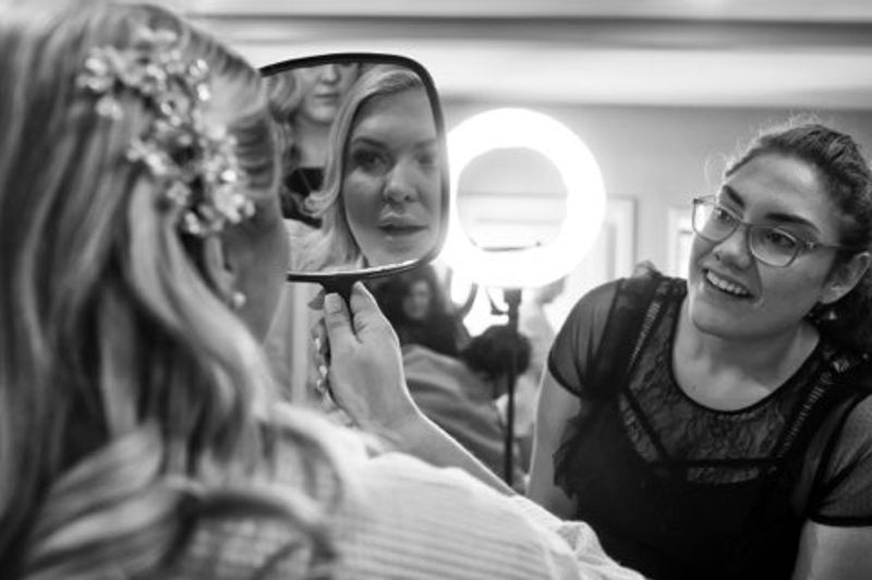 Bride looking at reflection