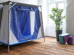 Travel pod in room