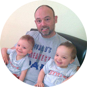 Dad holding twin boys