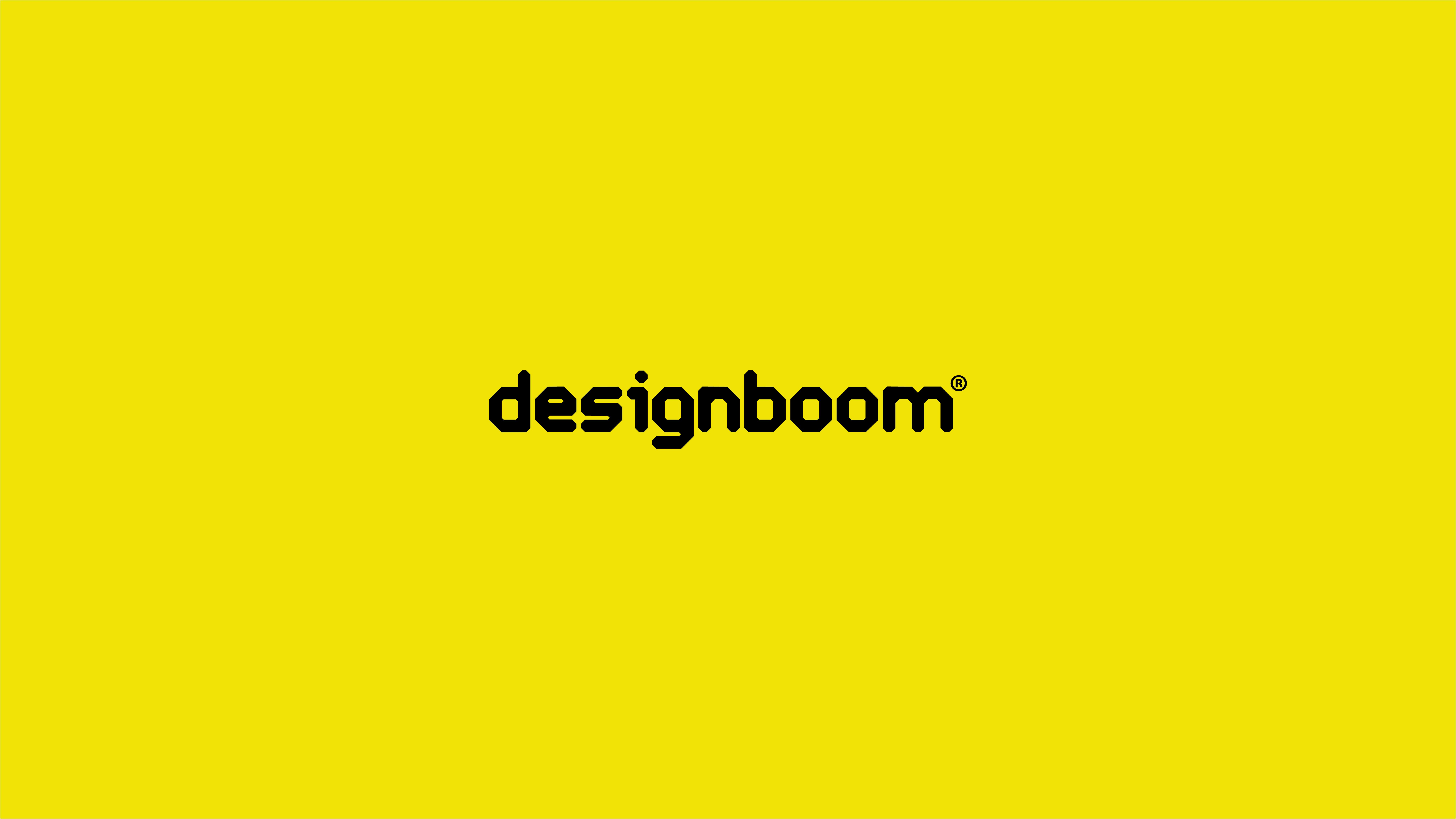 The word designboom on a yellow background