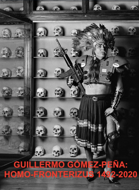 Book Cover. Guillermo Gomez-Pena in headdress, with automatic rifle, in front of many human skulls on shelves.
