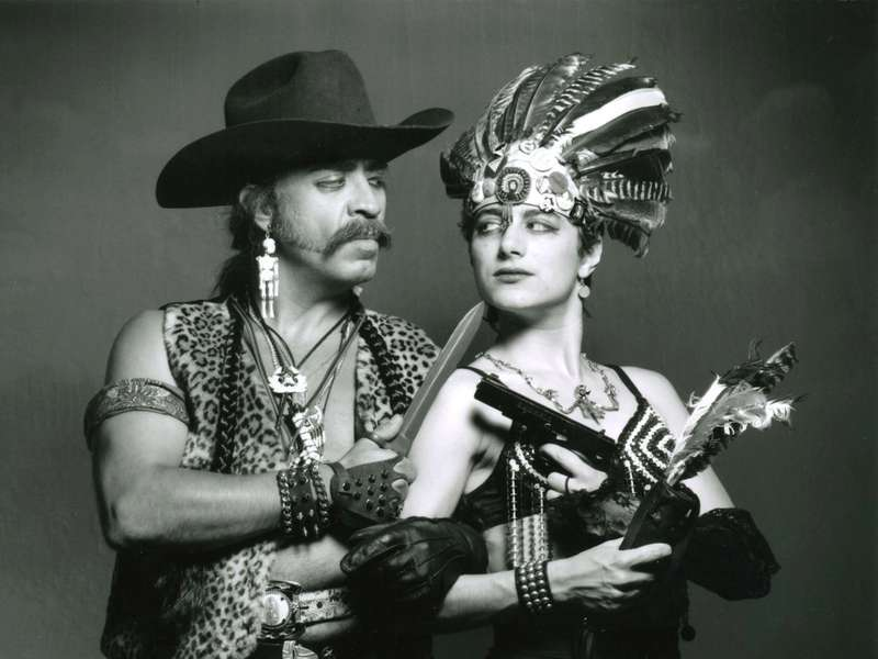 Guillermo Gómez-Peña and a female dressed in ethnic garb expressing intercultural fears and desires toward Latinos, immigrants and people of color.