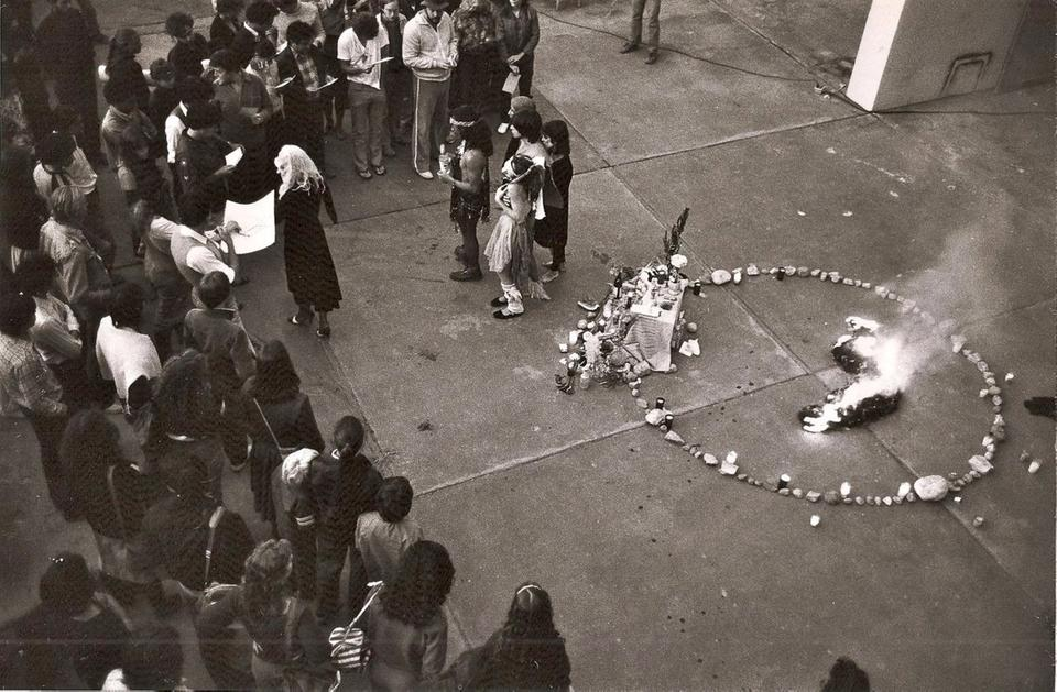 Aerial shot of a Poyesis Genetica performance involving a crowd of attendees.