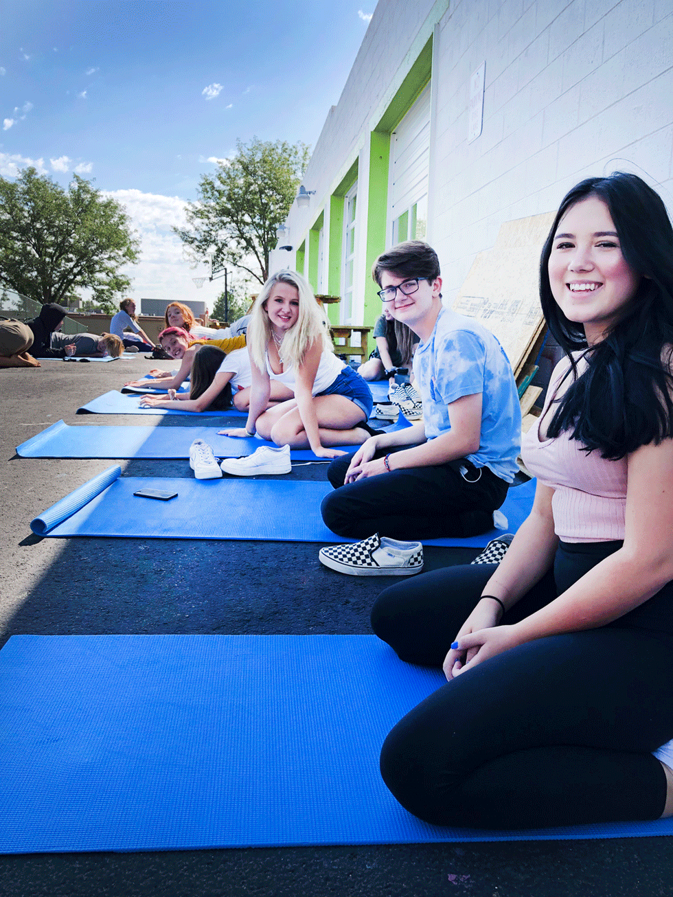 Outdoor yoga as part of our wellness experience