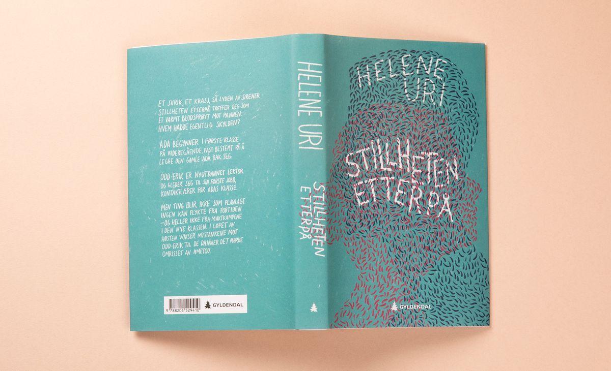 Turkis bok på lys rosa bakgrunn