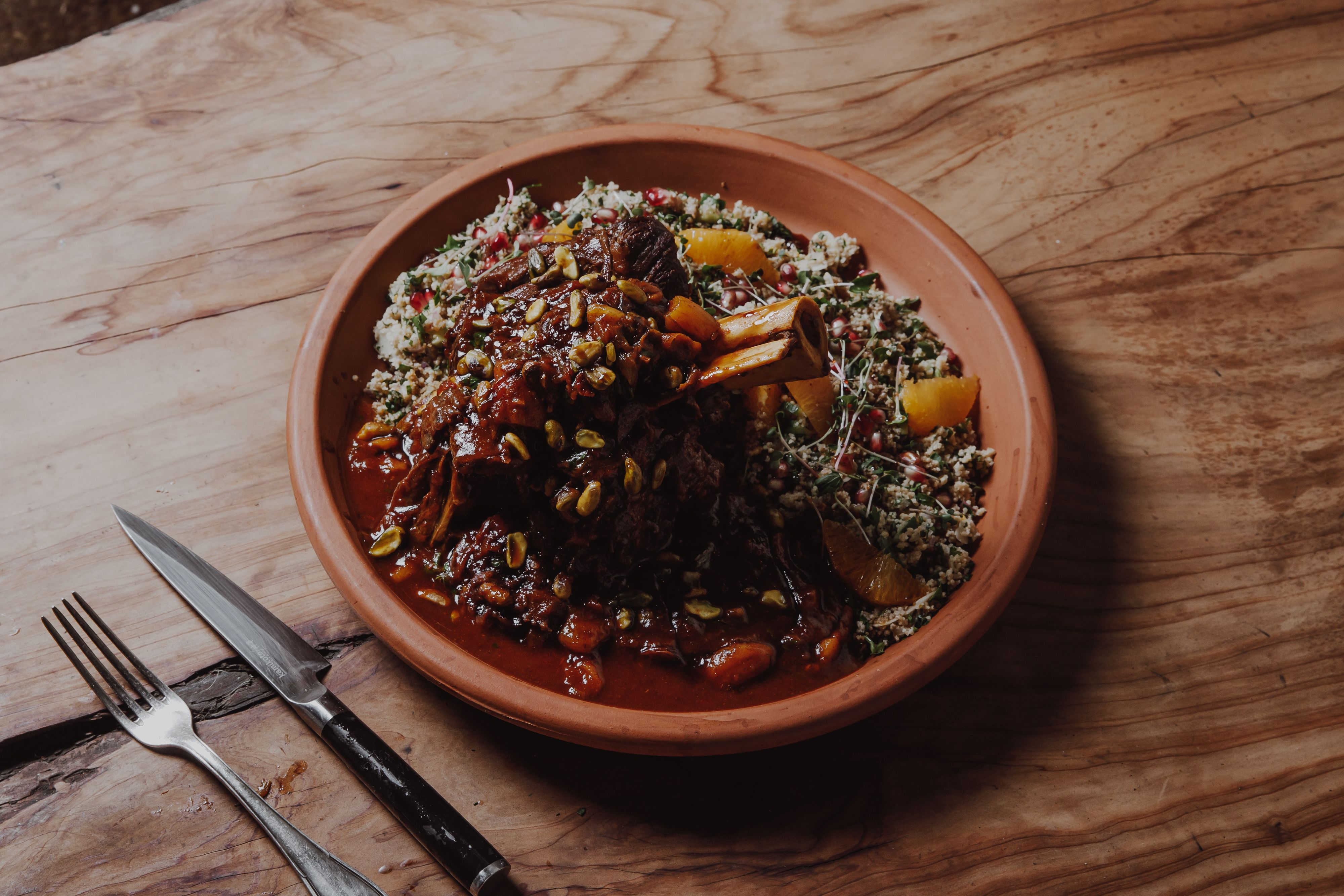 Shank Tagine with Pomegranate Cous Cous on plate