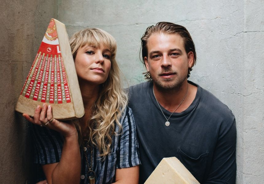 Sam & Ellie Studd of Studd Siblings holding large sections of Comte cheese