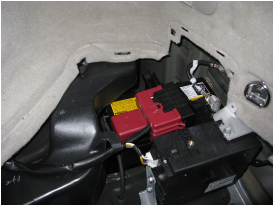 Prius 12V Battery - Located in RH Rear Corner of Vehicle. Note Red Plastic Cover Over The