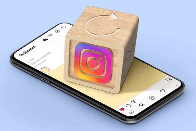 Toy block with instagram logo on top of phone
