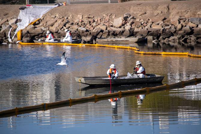 Crews clean up an oil spill in California