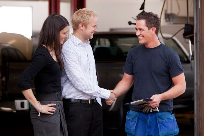 customer experience: three people are talking with two of them shaking hands