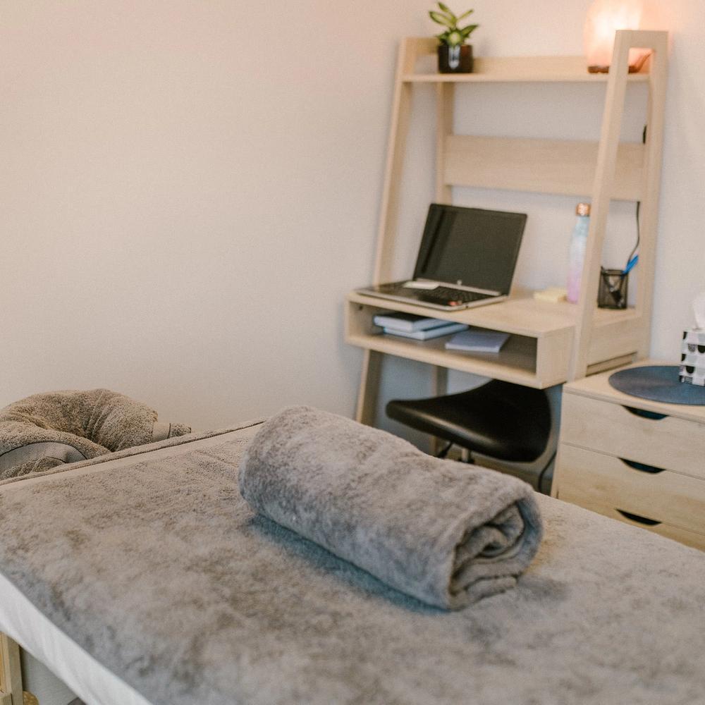 The massage table and office desk in the Hamilton Massage Company studio