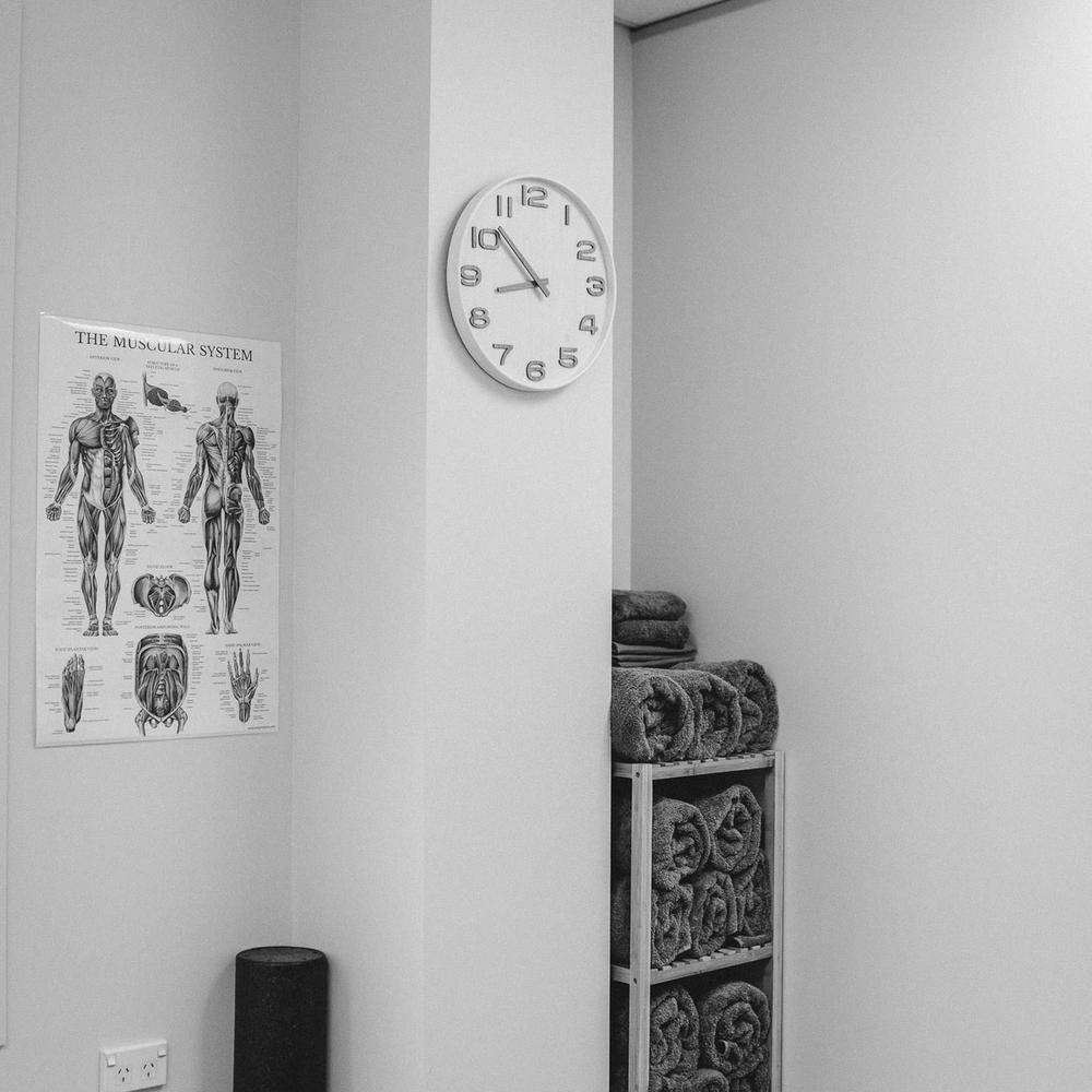 Towel rack and clock in the Hamilton Massage Company studio