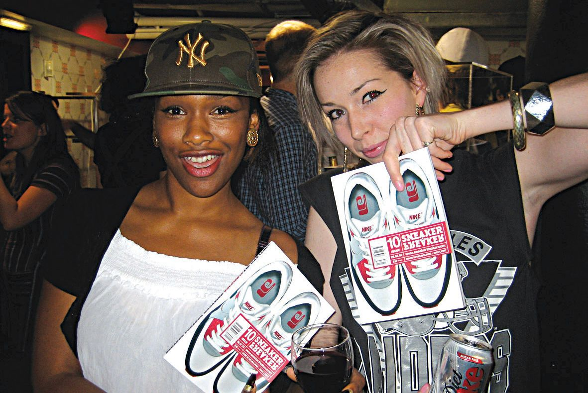 Two girls holding up copies of Sneaker Freaker Issue 10 at the launch in London