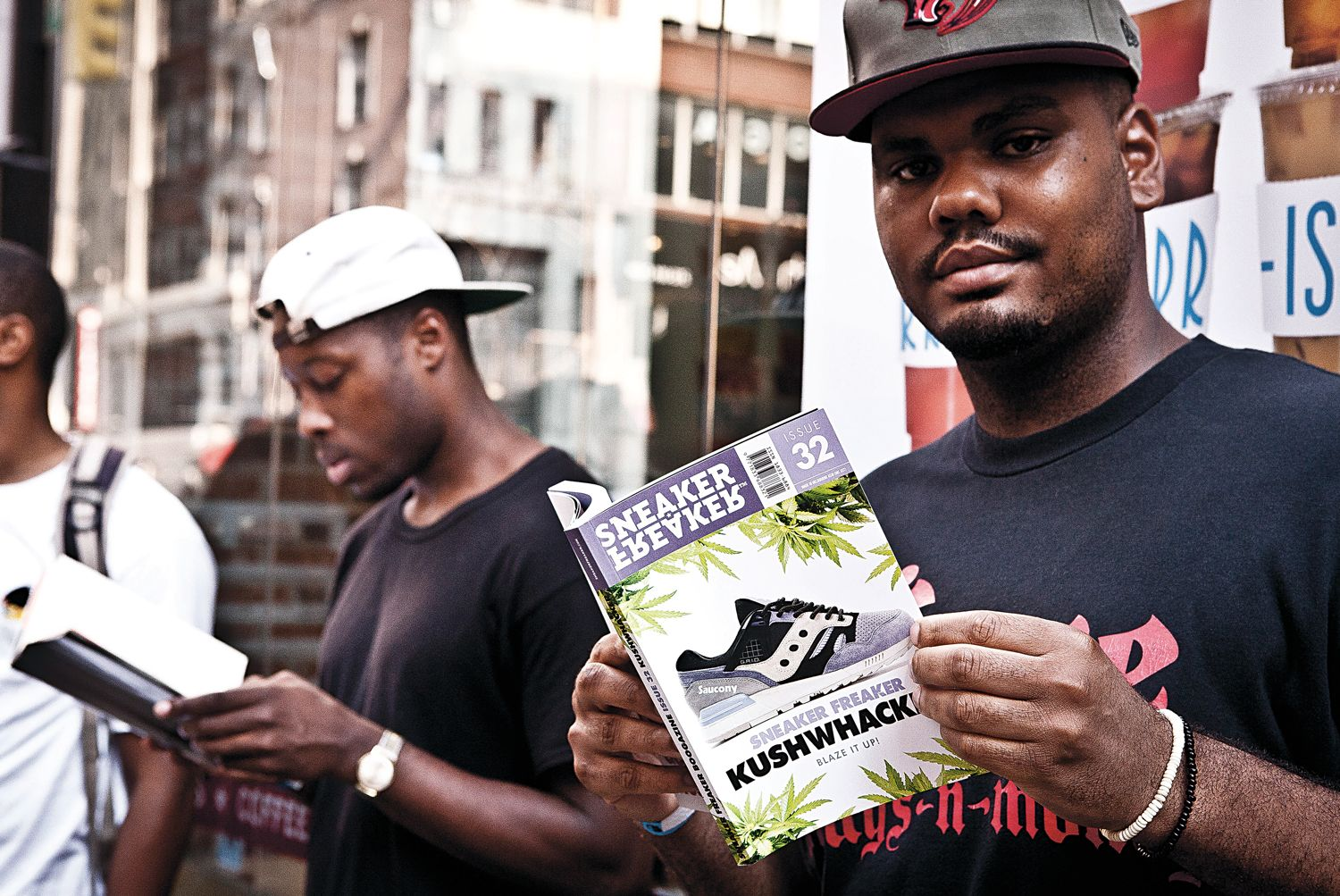 Man reading Sneaker Freaker Issue 32 at the SF x Packer x PUMA Bloodbath launch