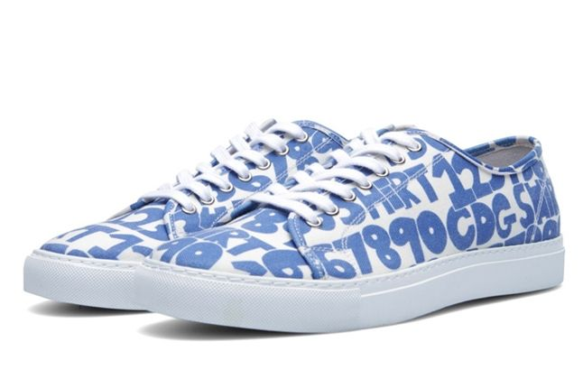 Comme Des Garcons Shirt X The Generic Man Print Sneaker Front Angle 1