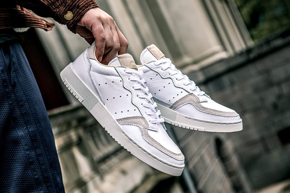 Adidas Supercourt On Foot Holding Heel