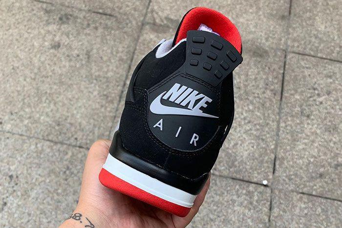 Air Jordan 4 Bred In Hand Up Close Right Nike Air Back