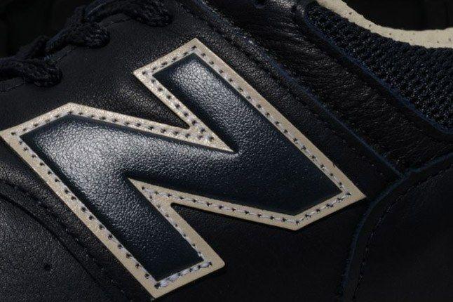 New Balance 576 Premium Leather Navy Logo Detail 1