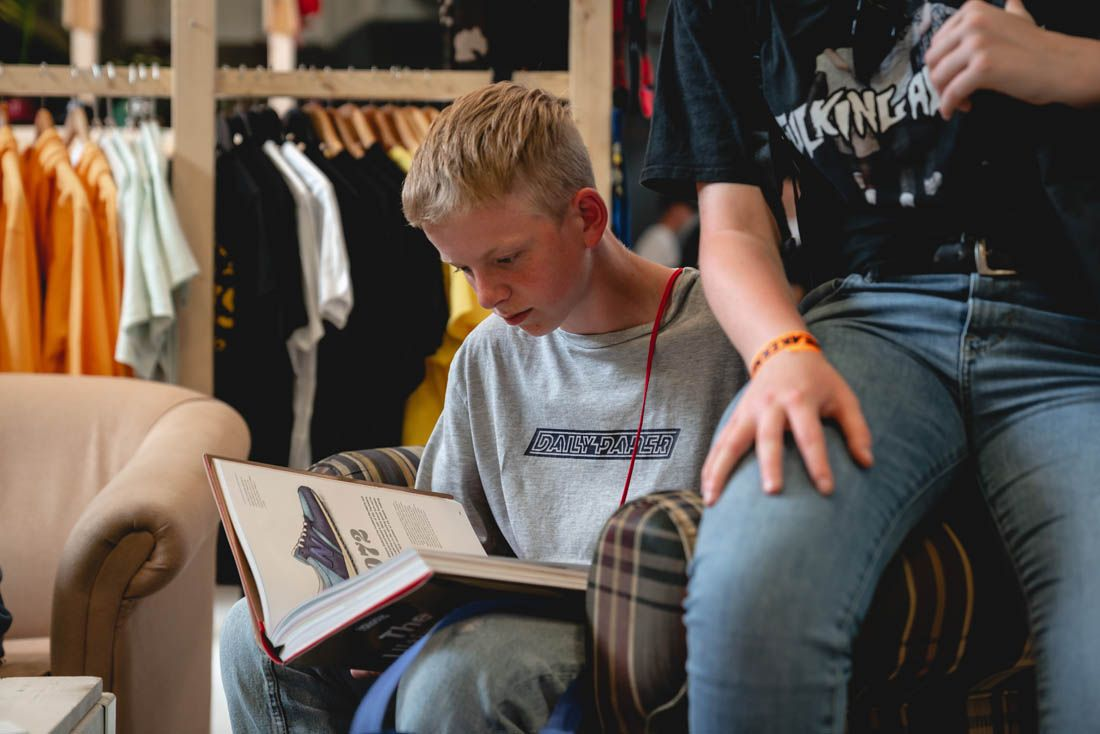 Sneakerness Amsterdam 2019 Event Recap 35 Booth Kid Reading
