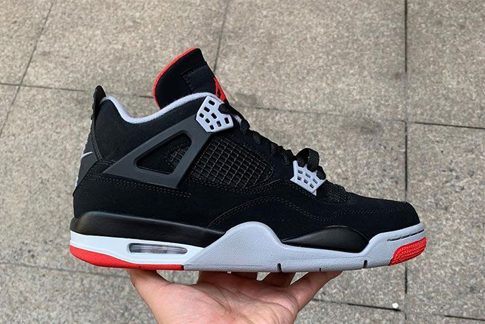 Air Jordan 4 Bred In Hand Up Close Right Side1