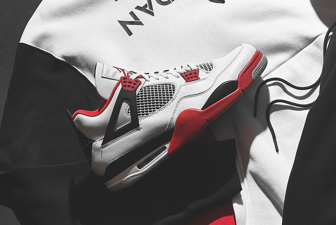 Air Jordan 4 'Fire Red' jd sports hero shot